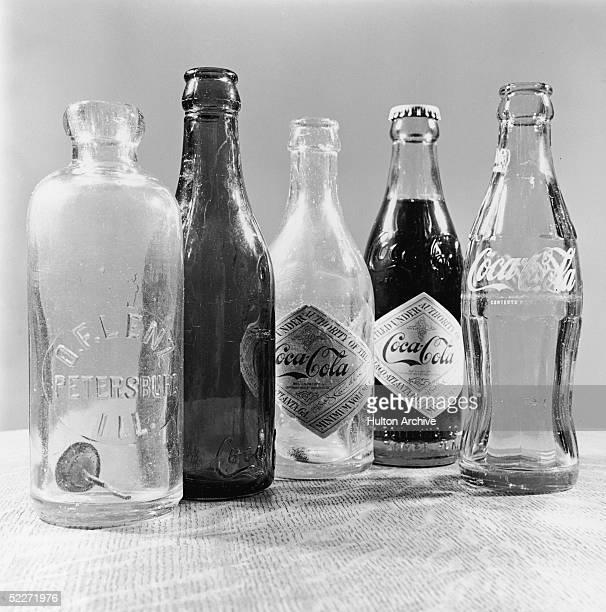 Photograph shows five soda bottles 1980s From left a straight side center slug bottle labelled 'OF Lenz Peterson Ill' dating from the early 1900s a...