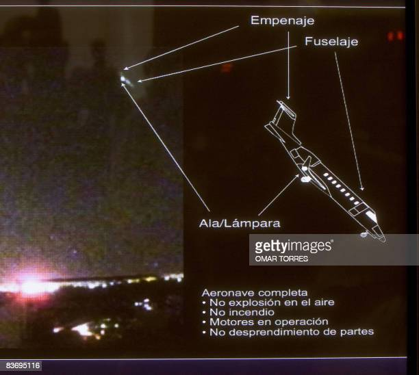 Photograph taken during the viewing of a video that catches the moment when the Lear Jet that crashed on November 4 in Mexico City passes over an...