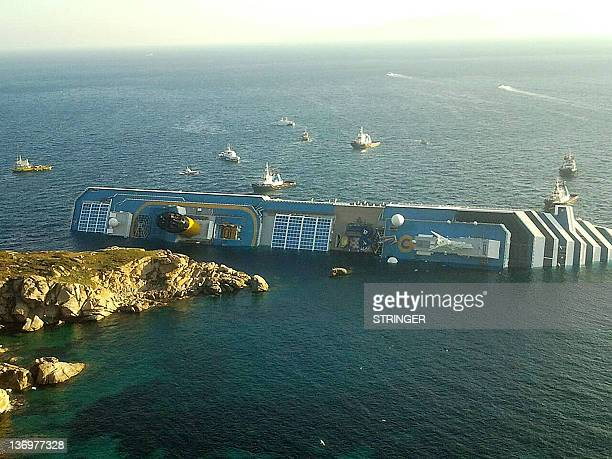 A photograph taken early on January 14 2012 of the Costa Concordia after the cruise ship with more than 4000 people on board ran aground and keeled...