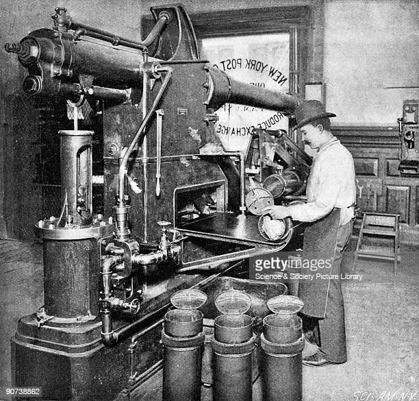 Photograph taken from 'Scientific American' showing a postal worker and the rear of a closed receiver Pneumatic mail tubes were first introduced in...