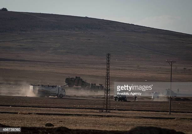 A photograph taken from Suruc district of Sanliurfa shows security measures are taken as Syrians fled the clashes between Islamic State of Iraq and...
