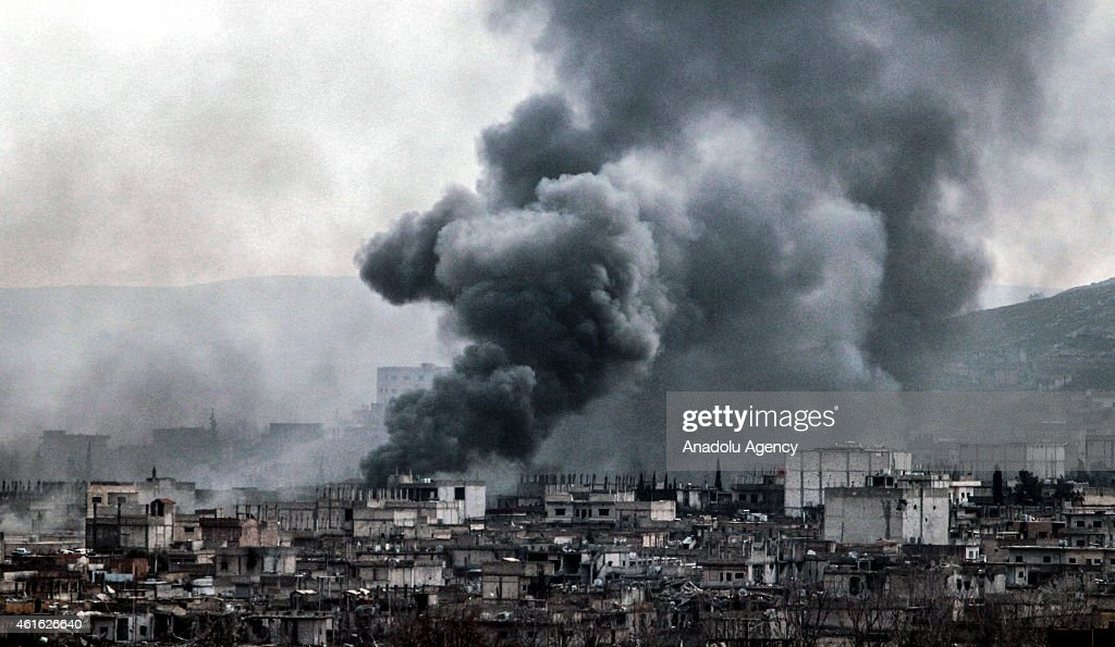 A photograph taken from Suruc district of Sanliurfa Turkey near TurkishSyrian border crossing shows smoke rising from the Syrian border town of...