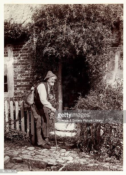 A photograph titled 'Jack of All Trades' taken by Colonel Joseph Gale in 1891 This photograph of an old handyman outside the open door of a cottage...