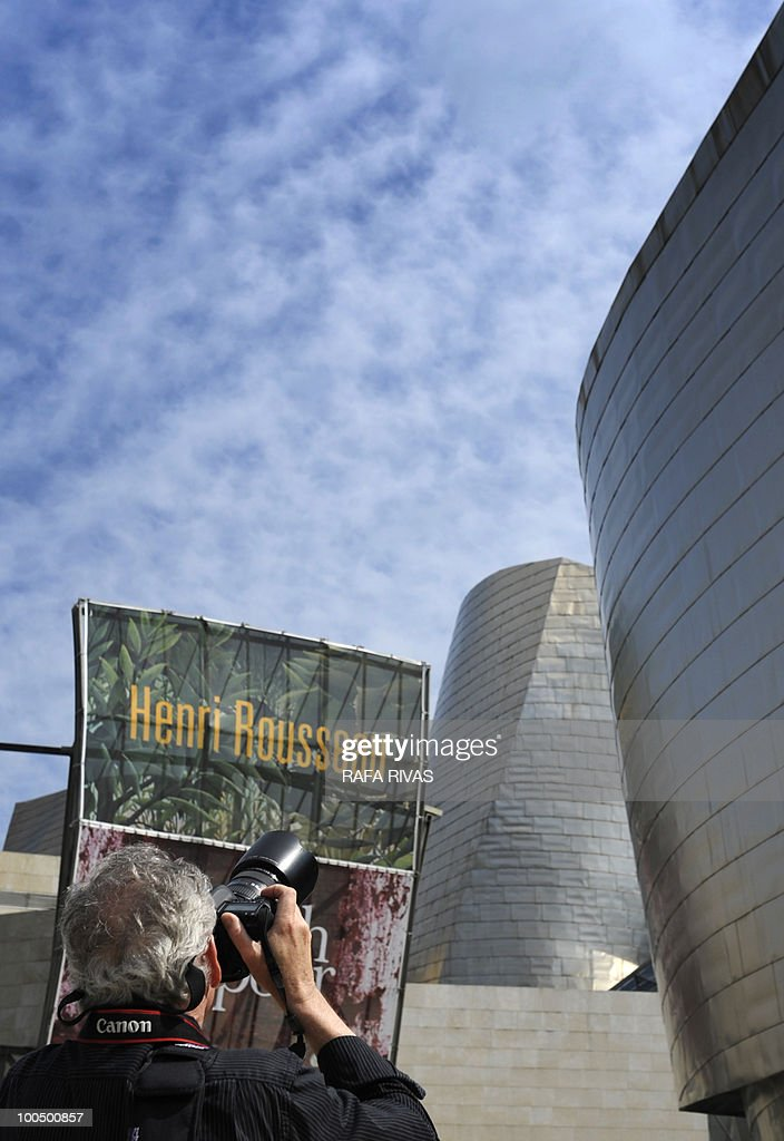 A photographe rtakes a picture of the poster announcing the new Guggenheim Bilbao museum temporary exhibition 'Henri Rousseau' taken on May 25, 2010, in the Northern Spanish Basque city of Bilbao. The exhibition, opened from May 25 untill September 12, 2010, includes thirty masterpieces providing a review of the French painter's career.
