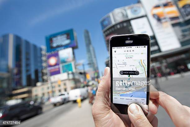 TORONTO ON MAY 14 Photographed at Dundas Square Toronto Uber taxi service is a new alternative way to traditional taxi to travel around the city...