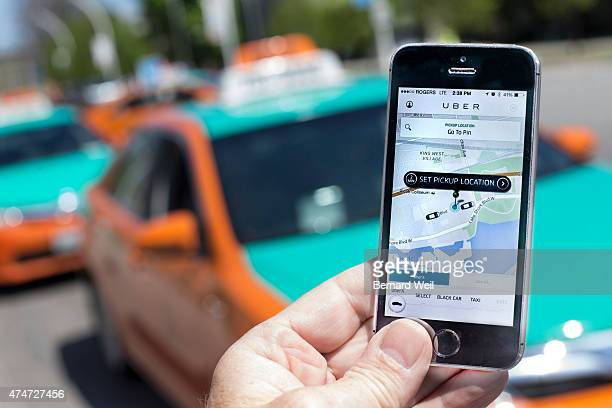 TORONTO ON MAY 14 Photographed at The CNE Toronto Uber taxi service is a new way to travel around the city Request and payment are all made using an...