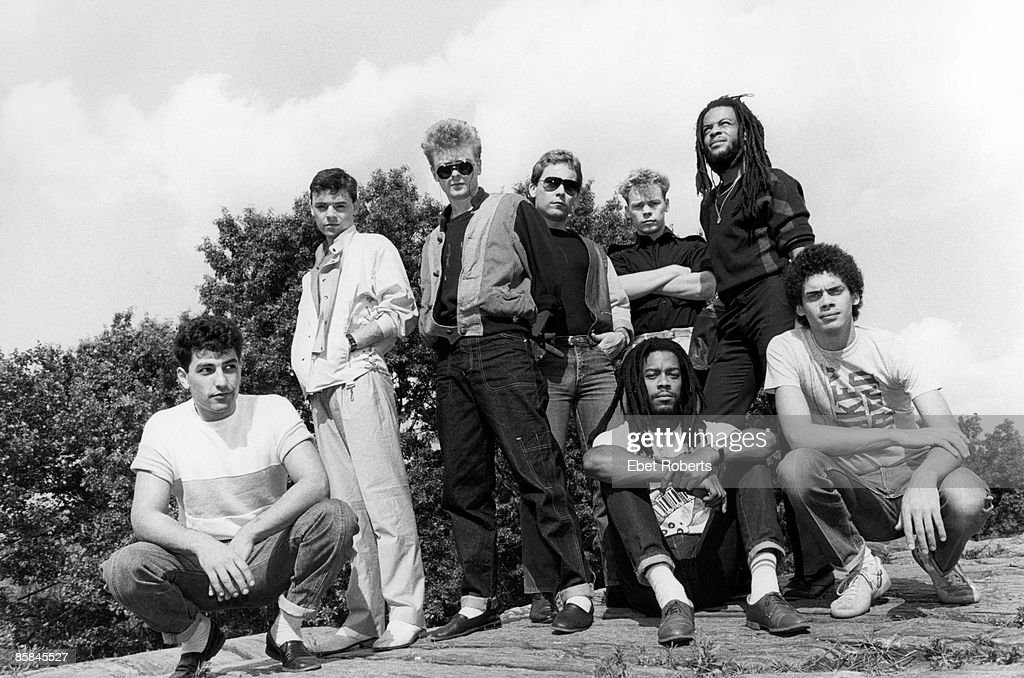 Photo of Robin CAMPBELL and Ali CAMPBELL and UB40; Back row L-R: Norman Hassan, Robin Campbell (?), Brian Travers, ?, Ali Campbell, Astro. Front L-R: Earl Falconer (?), James Brown