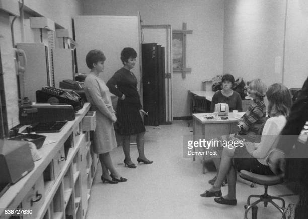 Photographed Through The Bulletproof Glass Of The Cashier's Cage At Wards Are The Five Cashiers From left are Charlene English Willie Cooper Mary...