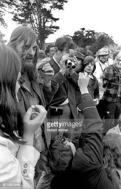 Photographer Alan Copeland and art director Harry Driggs film as somebody in the crowd shows off their joint on April 16 1969 at Golden Gate Park in...