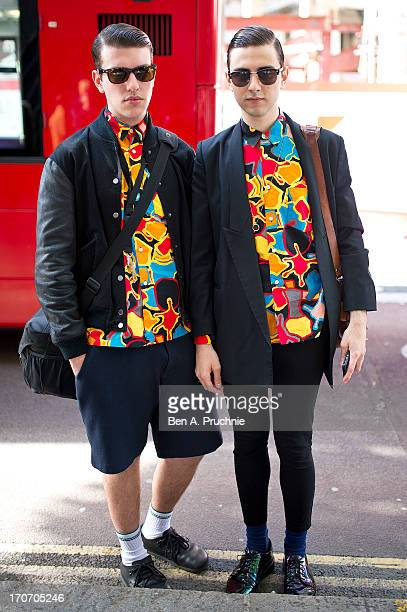 Photographer Alberto posses wearing a Comme Des Garcons shirt Cos shorts with Birkenstock shoes and a Stella Mccartney jacket and Photographer Stefan...