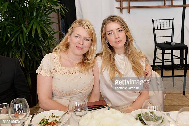 Photographer Amanda de Cadenet and actress Amber Heard attend NETAPORTER Celebrates Women Behind The Lens at Chateau Marmont on February 26 2016 in...
