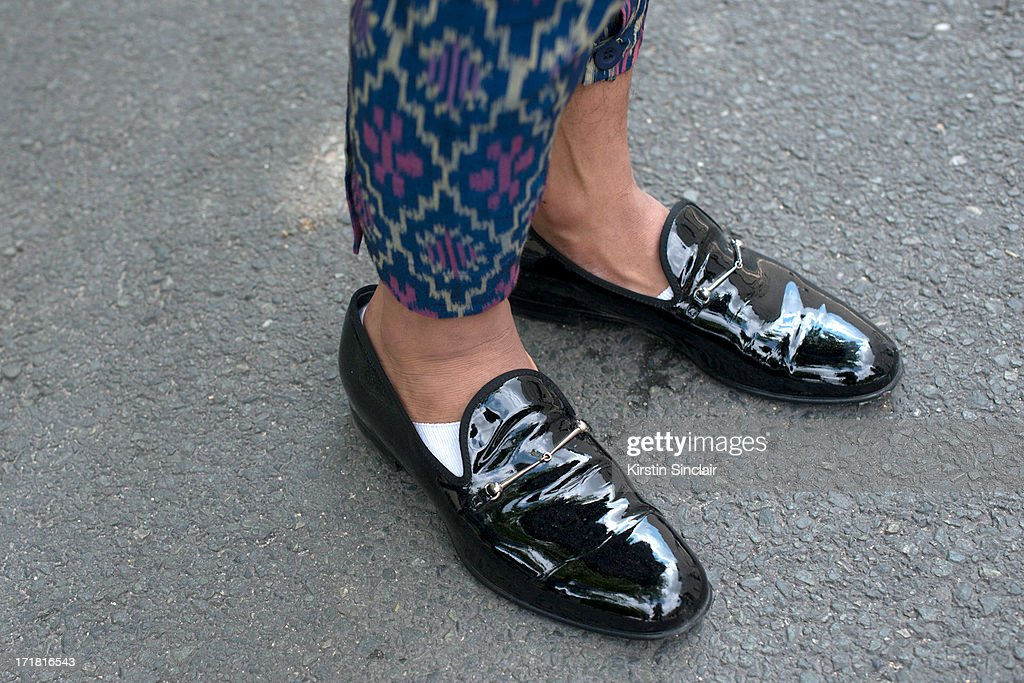 Photographer and Blogger Andy Suryandi wears Gucci shoes and Edbe trousers on day 3 of Paris Collections: Men on June 28, 2013 in Paris, France.