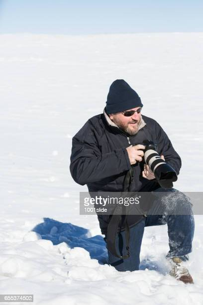 Photographer and Deep Snow at cold wild