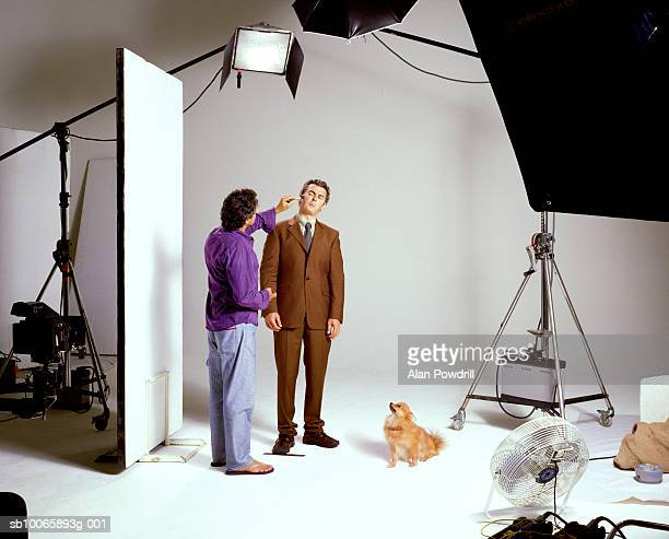Photographer and male model with dog in studio