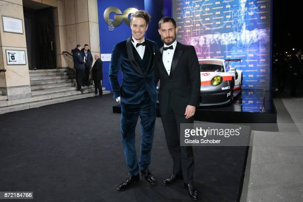 Photographer and model Simon Lohmeyer and actor Clemens Schick arrives for the GQ Men of the year Award 2017 at Komische Oper on November 9 2017 in...