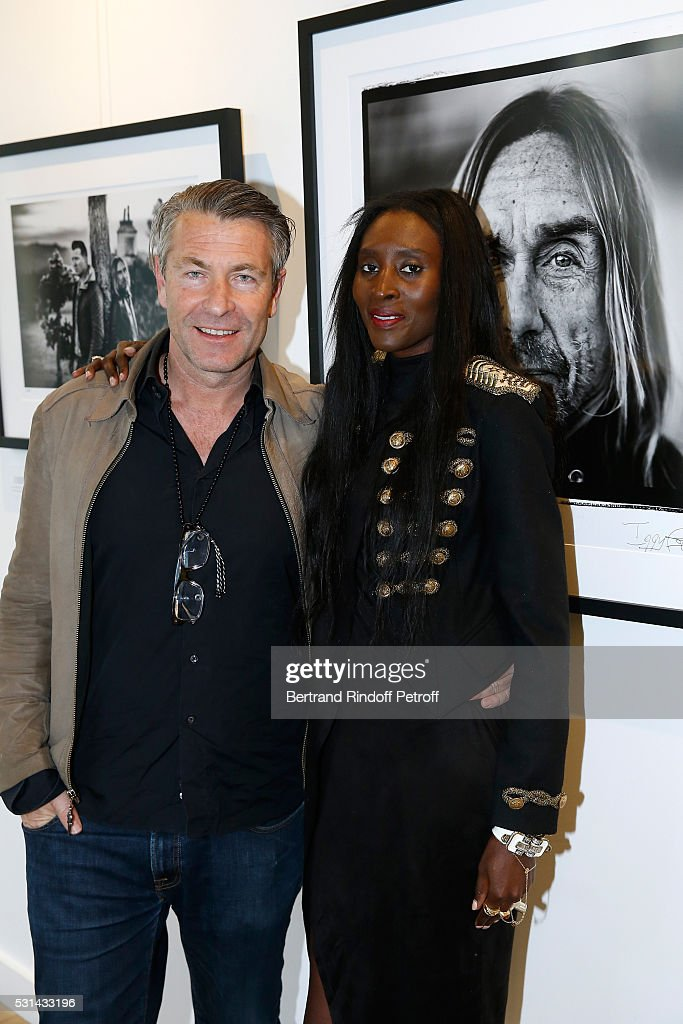 Photographer Andreas Neumann and his wife Khadija attend Iggy Pop 'Post Depression' Art Pictures Exhibition at French Paper Gallery on May 14, 2016 in Paris, France.