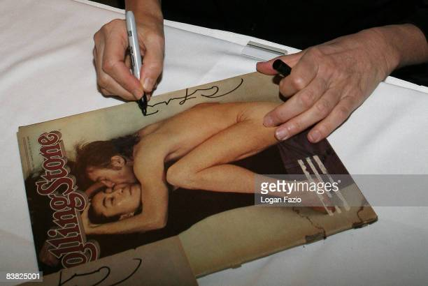 Photographer Annie Leibovitz autographs her iconic Rolling Stone cover photo featuring John Lennon and Yoko Ono at The Biltmore Country Club Ballroom...