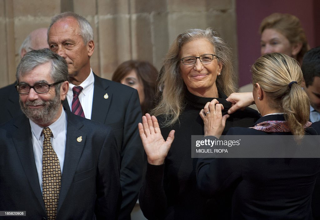 US photographer Annie Leibovitz (R), Spanish writer Antonio Munoz Molina (L) prepare for a family picture with the 2013 Prince of Asturias Award laureates and Spain's Crown Prince and his wife at the Reconquista Hotel of the northern Spanish city of Oviedo on October 25, 2013.