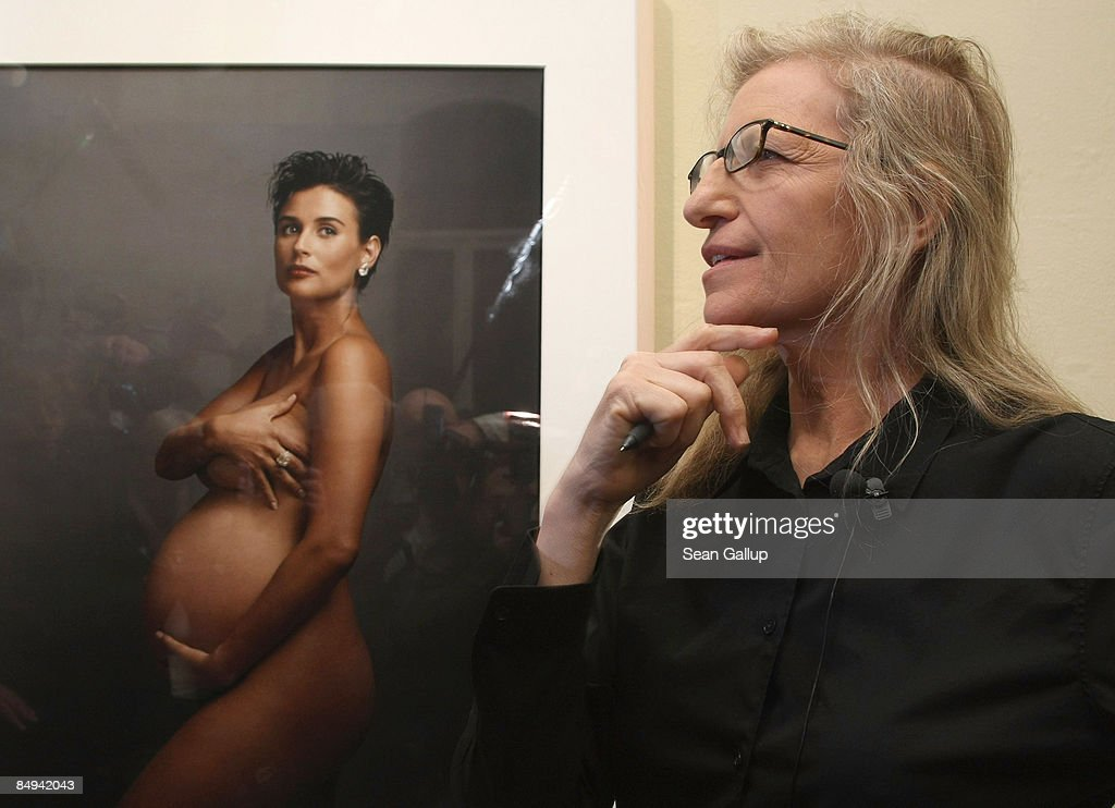 Photographer Annie Leibovitz speaks to the media while standing in front of a portrait of pregnant actress Demi Moore during a walk-through of the exhibition 'Annie Leibovitz - A Photographer's Life 1990-2005' at the C/O Gallery on February 20, 2009 in Berlin, Germany. The exhibition is open to the public from February 21 until May 24.