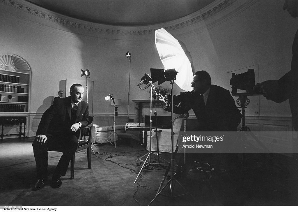 Photographer Arnold Newman takes a picture of President Lyndon B. Johnson in the Oval Office December 19, 1963 in Washington, DC.