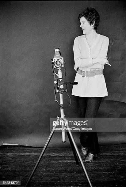 Photographer Barbara Waterston smokes as she stands in her studio with her camera on a tripod April 1968