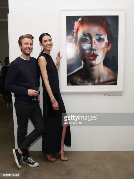 Photographer Benjamin Lennox and Model/actress Tao Okamoto attends the 'Tao Okamoto 15' Exhibition Opening at Hudson Studios on May 8 2014 in New...