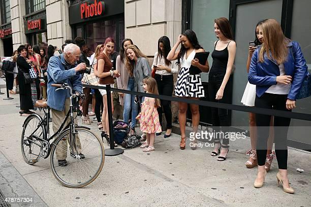 Photographer Bill Cunningham photographs model contestants outside the European Wax Center and Wilhelmina Summer Goddess Model Search New York Open...