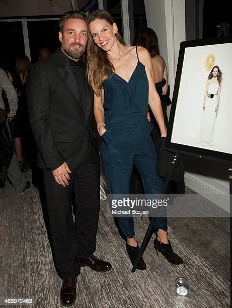 Photographer Brian Bowen Smith and Actress Hilary Swank attend Geraldo Jewelry Presents Icons Of The Awards on February 19 2015 in Los Angeles...