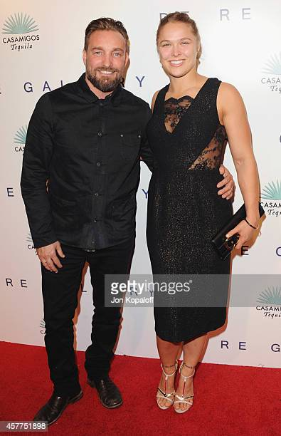 Photographer Brian Bowen Smith and UFC fighter Ronda Rousey arrive at De Re Gallery Casamigos Host The Opening Of First Ever Solo Show By Acclaimed...