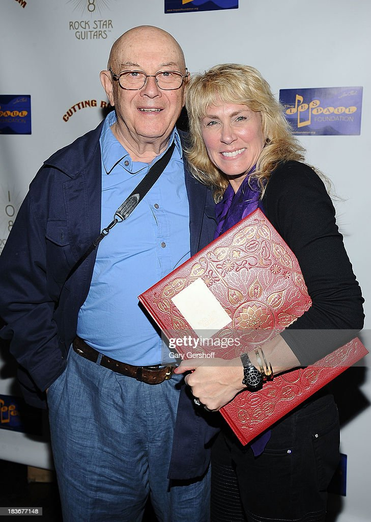Photographer Bruce Davidson (L) and author and photographer Lisa Johnson attend the book launch and performance for '108 Rock Star Guitars' benefitting The Les Paul Foundation at The Cutting Room on October 8, 2013 in New York City.