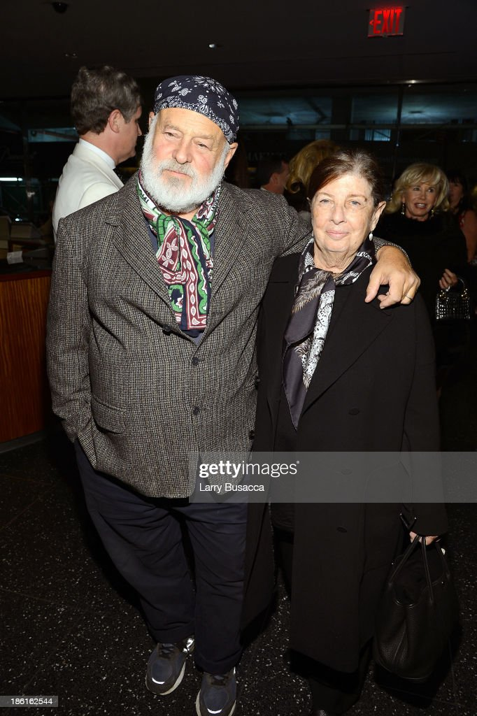 Photographer Bruce Weber (L) and Nan Bush arrive as Ralph Lauren Presents Exclusive Screening Of Hitchcock's To Catch A Thief Celebrating The Princess Grace Foundation at MoMA on October 28, 2013 in New York City.