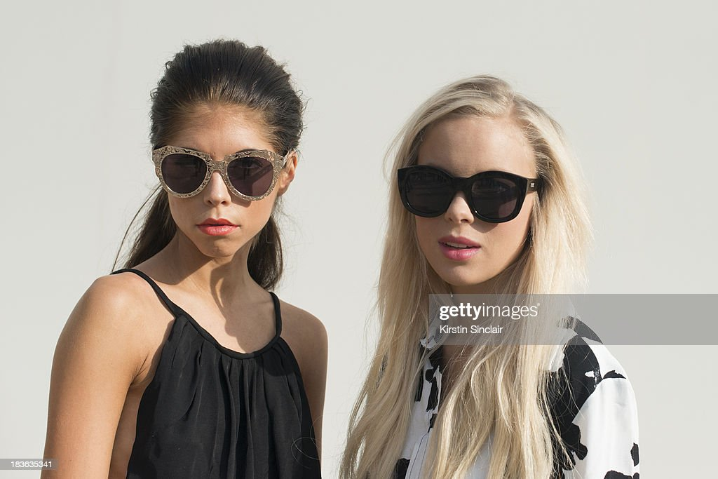 Photographer Caroline Roxy wearing an H and M jumpsuit and Karen Walker sunglasses and Fashion blogger Victoria Tornegren wearing a Top Shop top and Le Specs sunglasses on day 9 of Paris Fashion Week Spring/Summer 2014, Paris October 02, 2013 in Paris, France.
