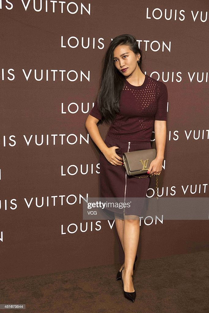 Photographer Chen Man attends Louis Vuitton flagship store opening ceremony at Chengdu IFS on July 3, 2014 in Chengdu, China.