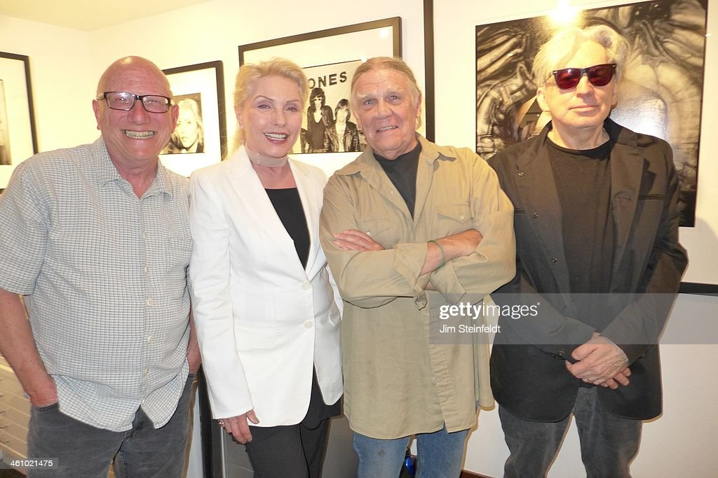 Photographer <a gi-track='captionPersonalityLinkClicked' href=/galleries/search?phrase=Chris+Stein&family=editorial&specificpeople=239488 ng-click='$event.stopPropagation()'>Chris Stein</a> on right of the rock band Blondie poses with (L-R) Richard Horowitz-gallery owner, <a gi-track='captionPersonalityLinkClicked' href=/galleries/search?phrase=Debbie+Harry&family=editorial&specificpeople=209145 ng-click='$event.stopPropagation()'>Debbie Harry</a>, and Henry Diltz-photographer/gallery owner at the Morrison Hotel Gallery at the Sunset Marquis Hotel in Los Angeles, California on August 9, 2013.