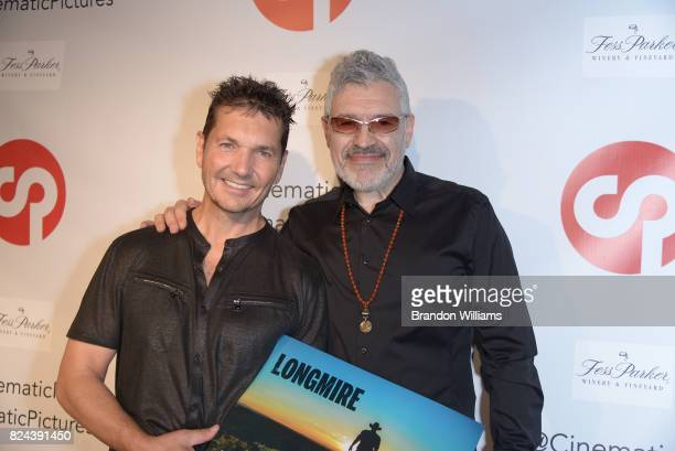 Photographer / curator TJ Scott and Dennys Ilic attend the reveal of the 'Longmire' coffee table book by Cinematic Pictures Group Publishing at...