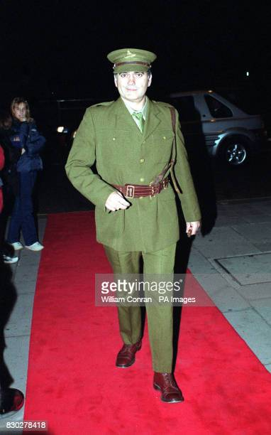 Photographer Dave Bennett arriving at the Blitz Ball at the Park Home Hotel in London