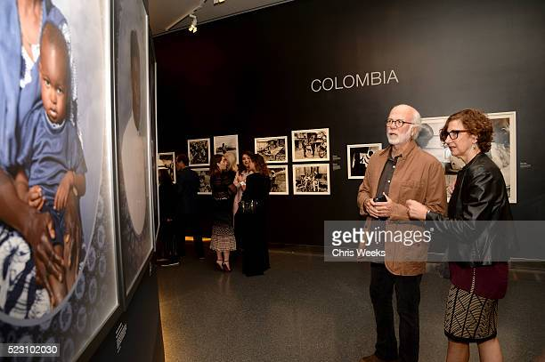 Photographer David Hume Kennerly and Rebecca Soladay attend the opening of REFUGEE Exhibit at Annenberg Space For Photography on April 21 2016 in...