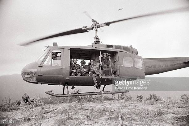 Photographer David Hume Kennerly sits with US and Vietnamese soldiers aboard a US military helicopter on a hot landing zone in 1971 in the Central...