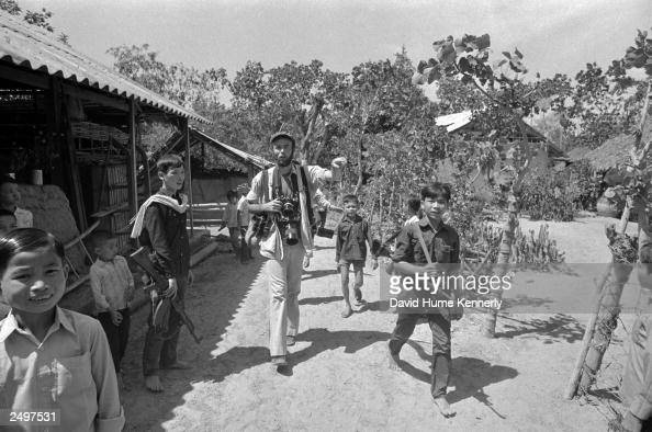 Photographer David Hume Kennerly walks through a Viet Cong Village in 1973 in the Mekong Delta in Vietnam