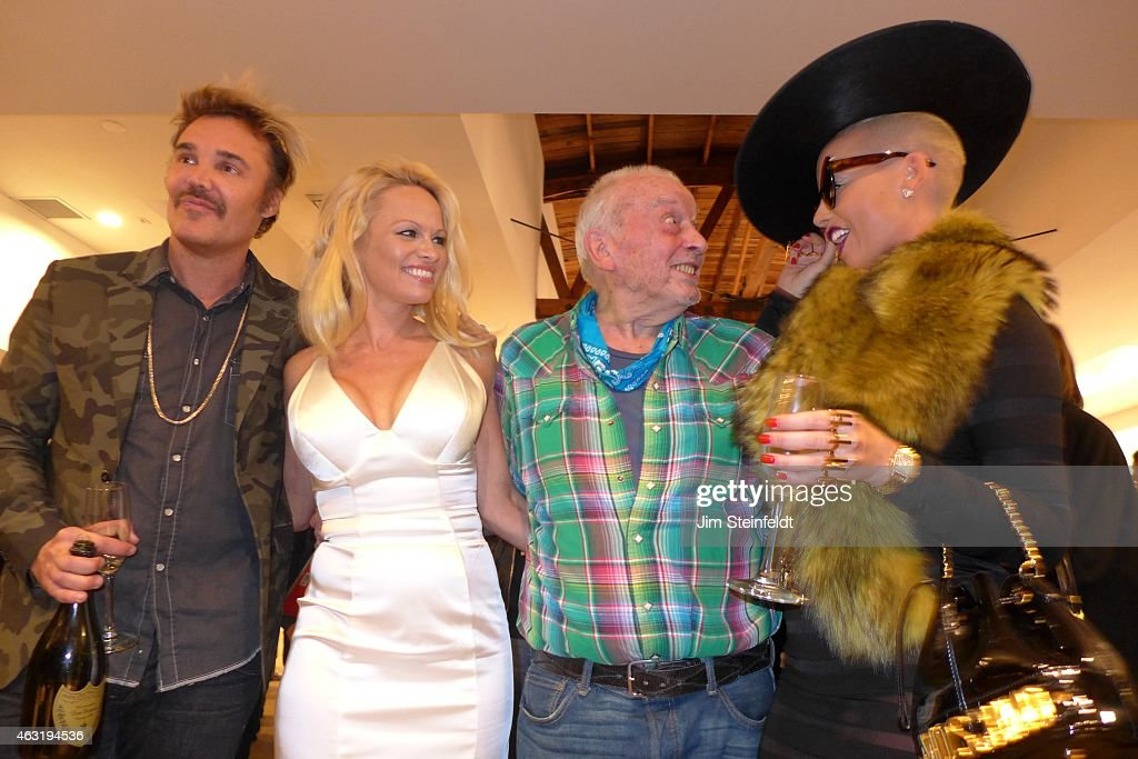 Photographer <a gi-track='captionPersonalityLinkClicked' href=/galleries/search?phrase=David+LaChapelle&family=editorial&specificpeople=204135 ng-click='$event.stopPropagation()'>David LaChapelle</a>, actress <a gi-track='captionPersonalityLinkClicked' href=/galleries/search?phrase=Pamela+Anderson&family=editorial&specificpeople=171759 ng-click='$event.stopPropagation()'>Pamela Anderson</a>, photographer <a gi-track='captionPersonalityLinkClicked' href=/galleries/search?phrase=David+Bailey+-+Photographer&family=editorial&specificpeople=216323 ng-click='$event.stopPropagation()'>David Bailey</a>, and model <a gi-track='captionPersonalityLinkClicked' href=/galleries/search?phrase=Amber+Rose+-+Model&family=editorial&specificpeople=2025513 ng-click='$event.stopPropagation()'>Amber Rose</a> pose for a portrait at the Taschen Gallery in Los Angeles, California on December 13, 2014.