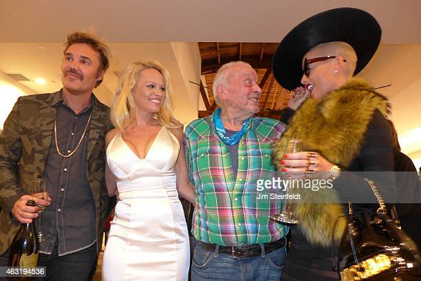 Photographer David LaChapelle actress Pamela Anderson photographer David Bailey and model Amber Rose pose for a portrait at the Taschen Gallery in...