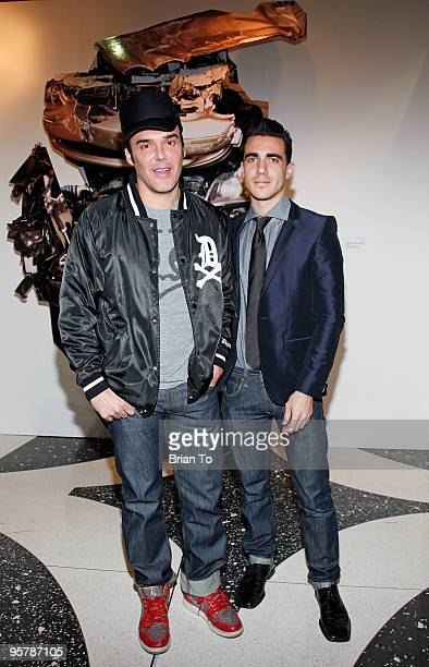 Photographer David LaChapelle and boyfriend Drew Kuhse pose in front of LaChapelle's art photography at the 19th Annual International Los Angeles...