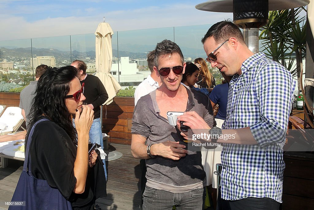 Photographer Davis Factor (C) attends Flaunt Magazine and Samsung Galaxy celebrate The Plutocracy Issue release hosted by Russell Westbrook at Caulfield's Bar and Dining Room at Thompson Hotel on March 2, 2013 in Beverly Hills, California.