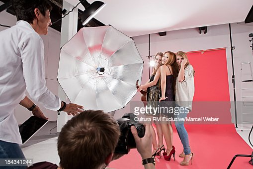 Photographer directing models at shoot
