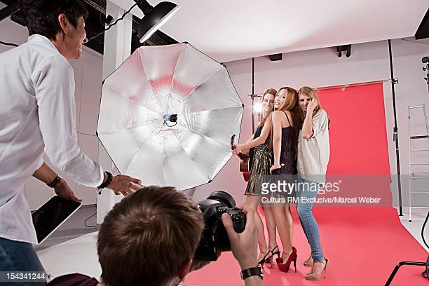 Photographer directing models at shoot
