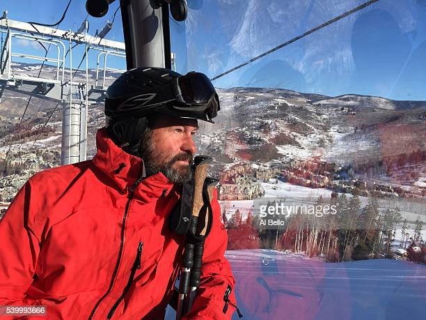 Photographer Doug Pensinger rides a gondola lift in Beaver Creek Colorado