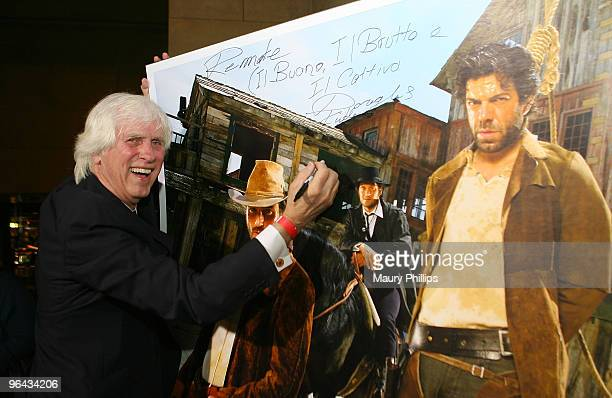 Photographer Douglas Kirkland signs one of his photographs during the opening night of Cinema Italian Style 2009 US premiere of the 'Baaria' at the...