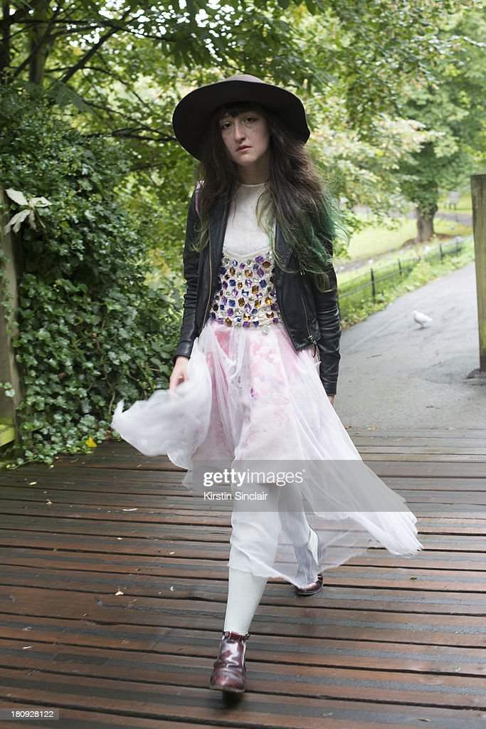 Photographer Eleanor Hardwick wears Top Shop boots, vintage dress, jacket and hat, Jeremy Scott bag and a Sretsis skirt on day 5 of London Fashion Week Spring/Summer 2013, at Somerset House on September 17, 2013 in London, England.