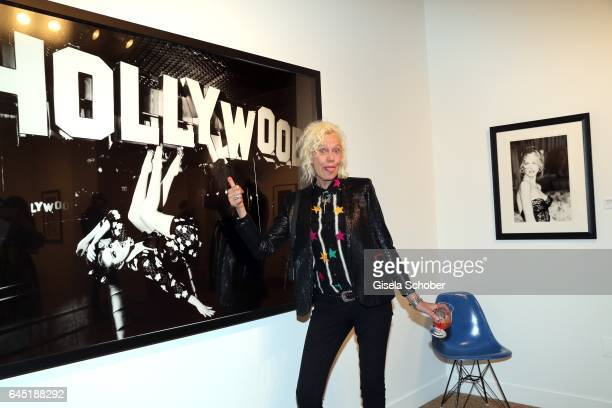 Photographer Ellen von Unwerth in front of her photo during the opening night of Ellen von Unwerth's photo exhibition at TASCHEN Gallery on February...