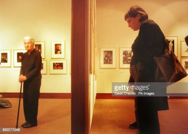 Photographer Eve Arnold stands at the opening of the first exhibition to bring together the work of the women photographers of the Magnum agency The...